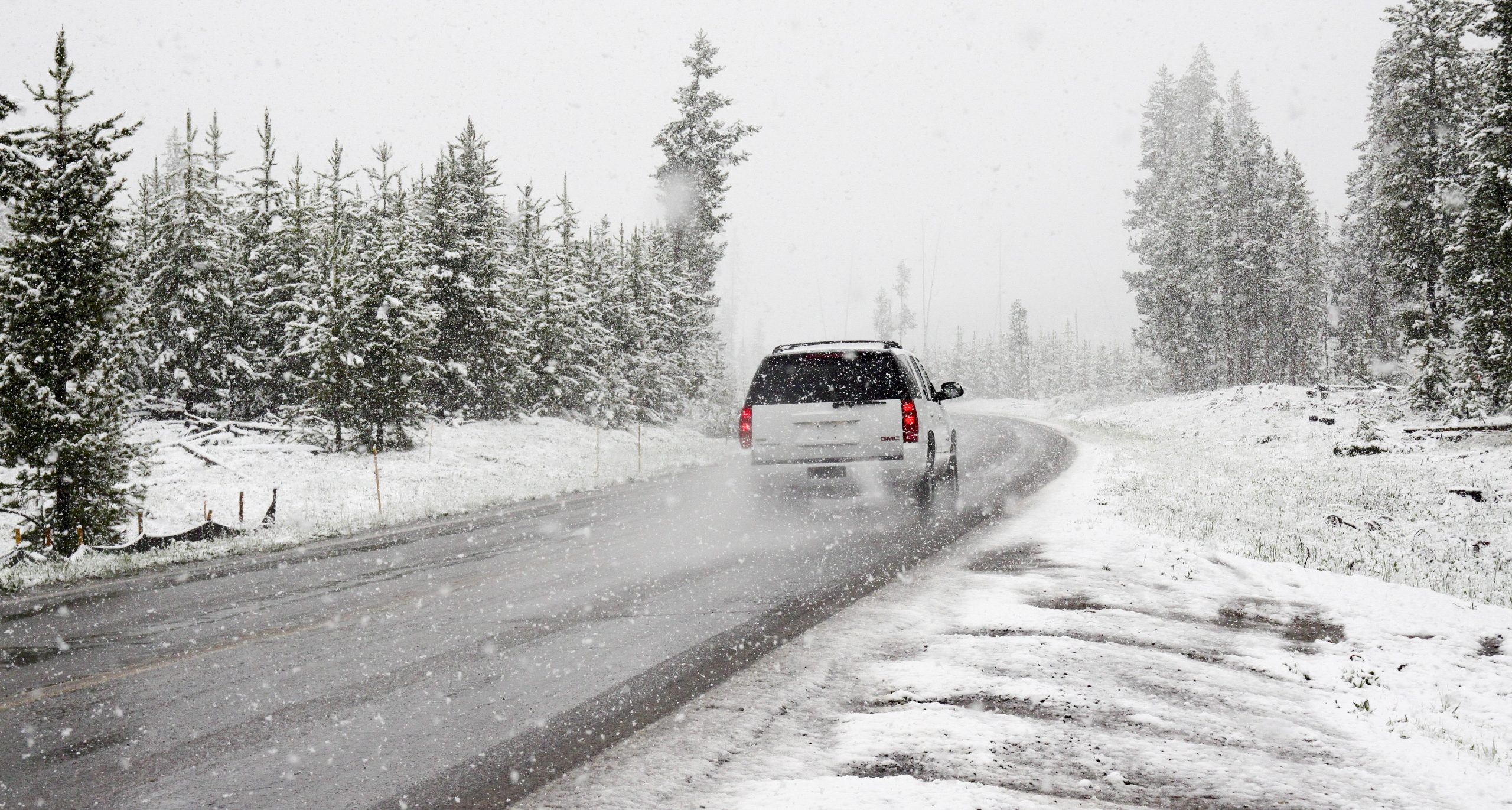 car driving on a snowy road