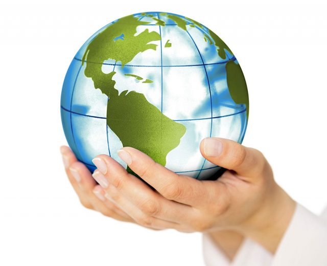 hands holding a model of earth for earth day
