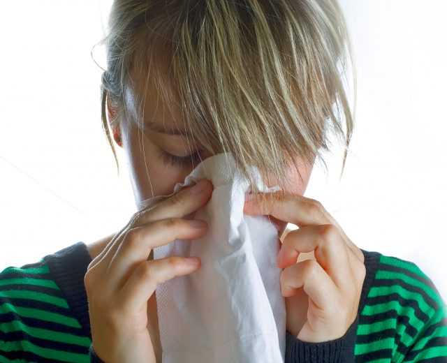 person blowing nose