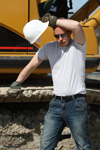 construction worker wiping his forehead in the heat