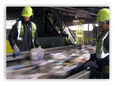 two men working in a recycling processing plant