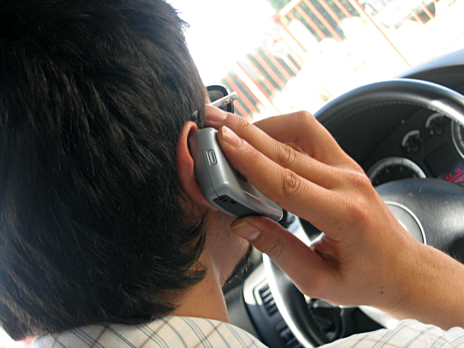 person driving while on the cell phone