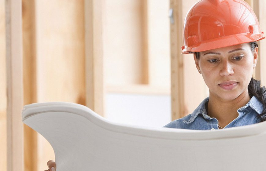 girl wearing hard hat on construction site