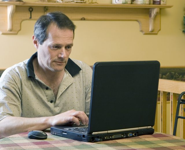 A man on a laptop working from home