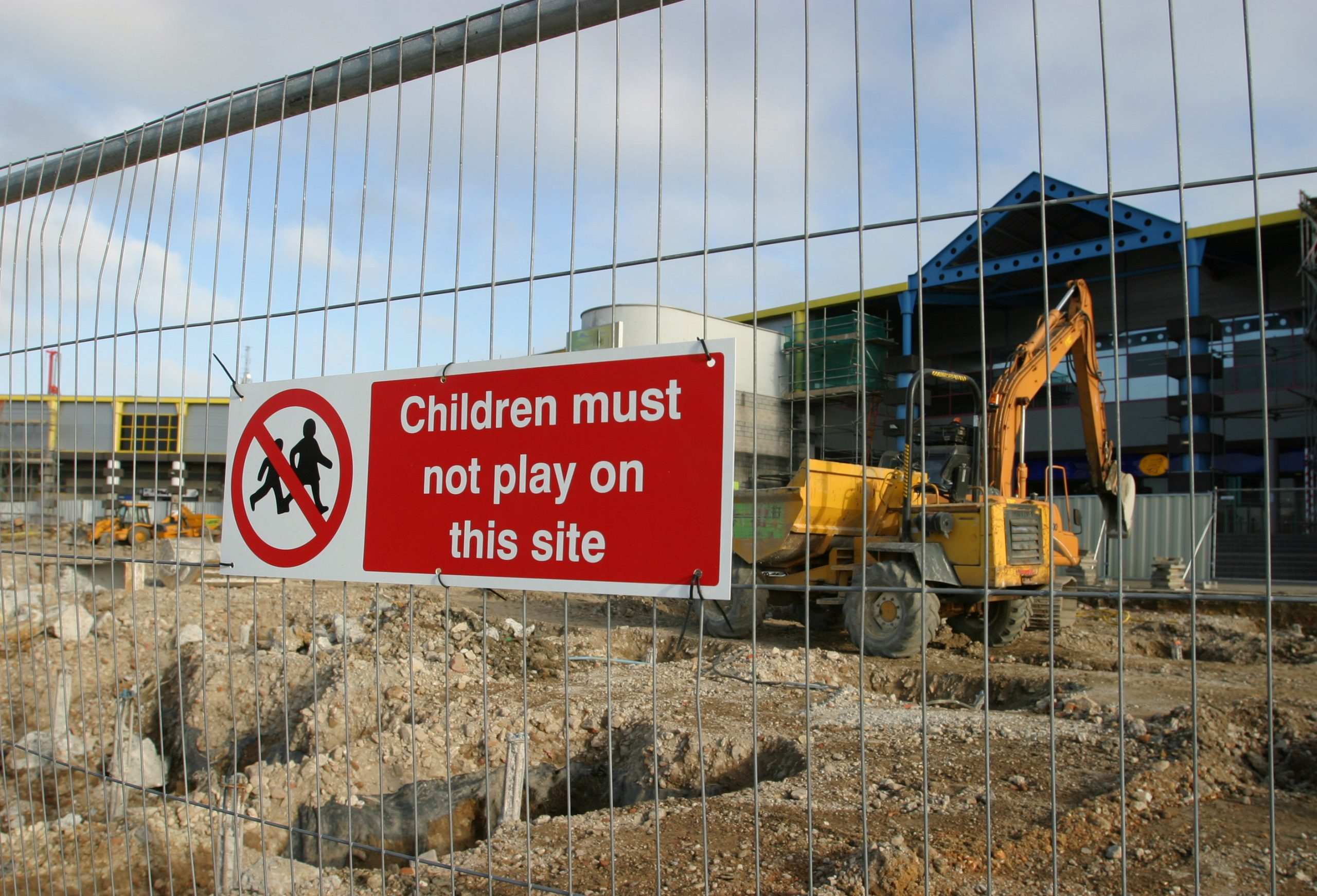 Construction site with sign children may not play