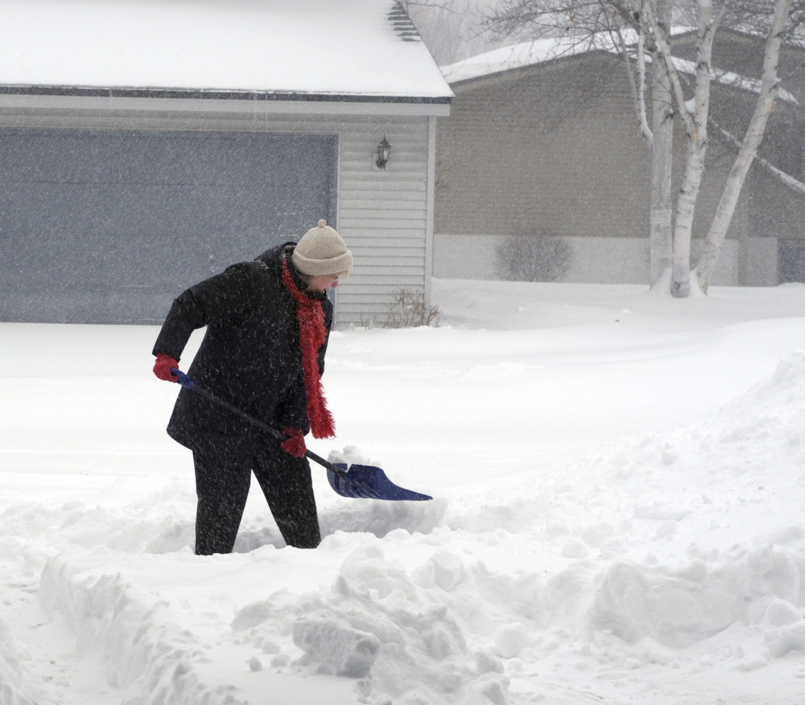 Woman Shoveling Path in Snow