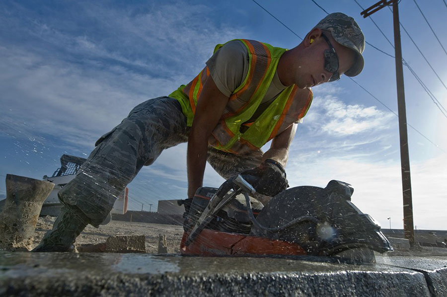 man working with silica on a job site