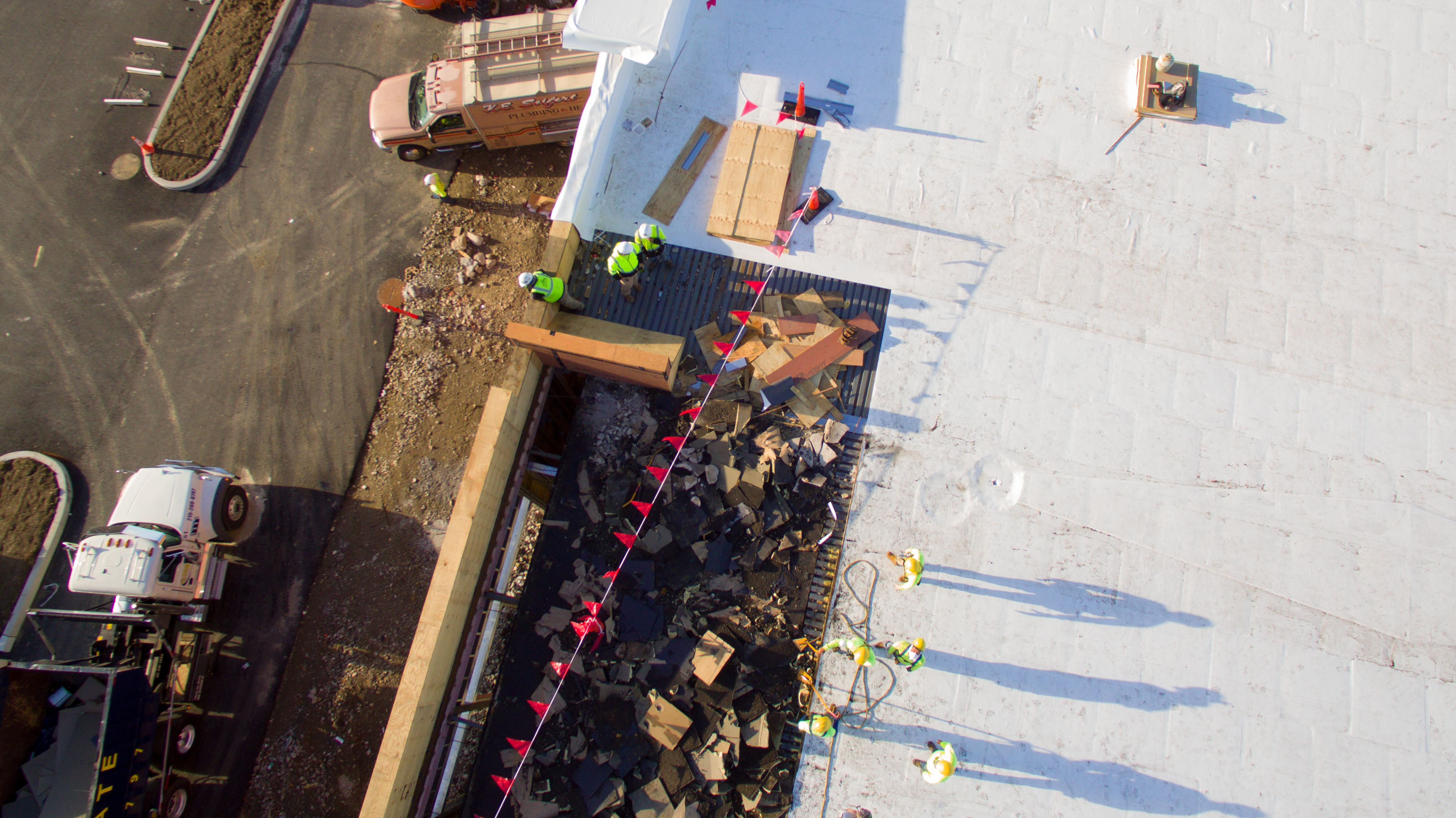 construction-workers-on-rooftop-aerial-view