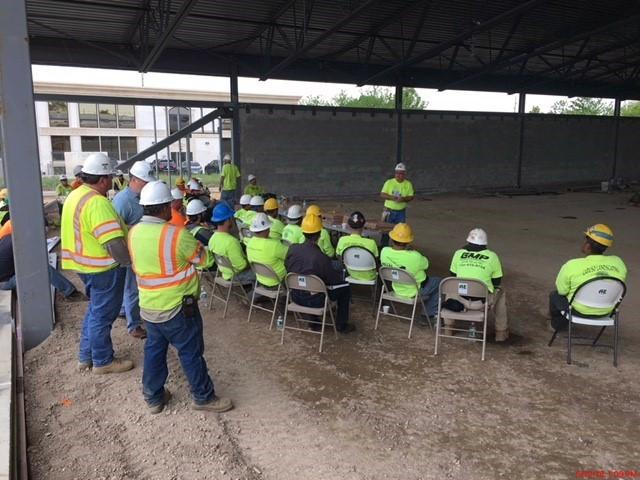 construction workers safety meeting at a job site