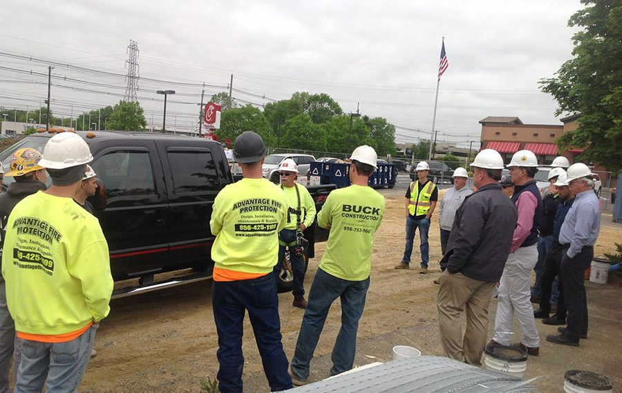 construction team meeting on a job site