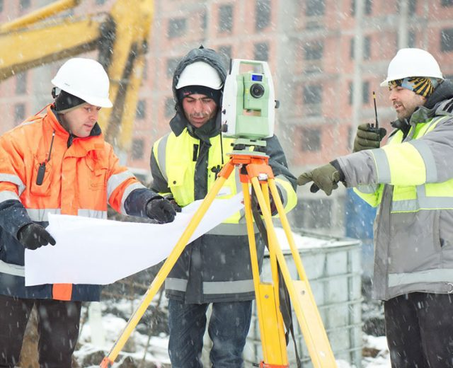 construction inspectors working outdoors in snow