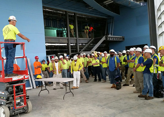 meeting of construction workers at a job site
